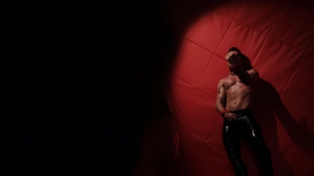 itaatkâr : Brutal muscular man in the red room dancing. stripper handcuffed