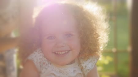 buço : Portrait of beautiful curly girl in sunset light. Happy curly girl