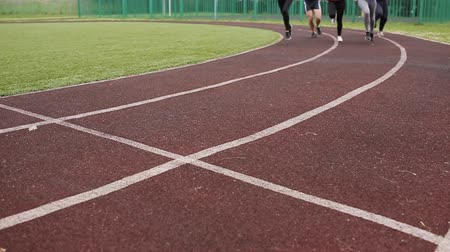 stopy : athletes, mans and womans running on running track