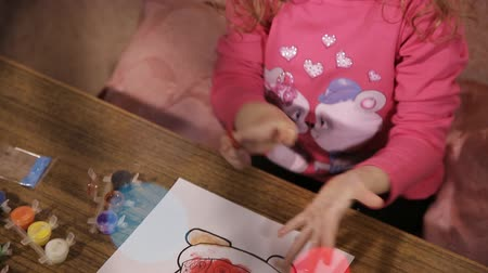 девчушки : little girl draws a painting of Santa Claus