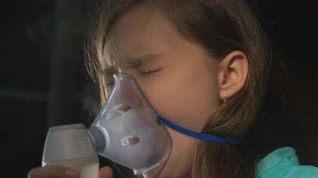 asthma : Inhalation Sick Girl with Inhaler in Living Room