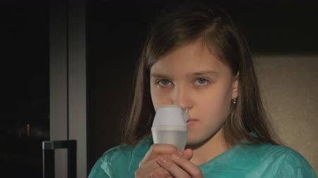 asthma : nebulizer, cute girl using inhaler Stock Footage