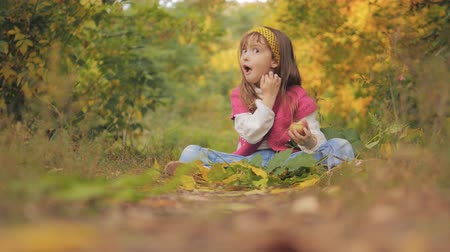 snack : 4K Girl Portrait Eating Apple Fruit Autumn Forest View, Child Eats Snack Outdoor Stock Footage