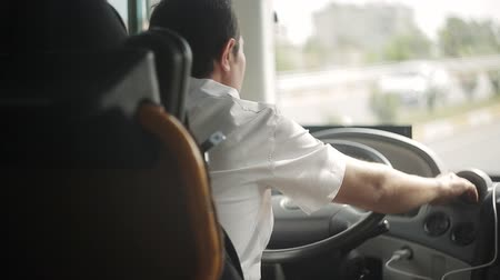 inside bus : The bus driver is driving along the road. Stock Footage