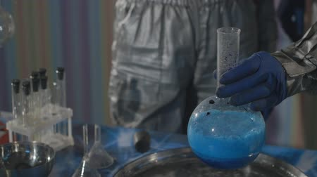methamphetamine : Chemists make drugs in the laboratory.