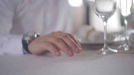 caresses : man at the restaurant table. close-up of a hand Stock Footage