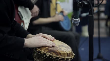 aborigine : male hands play a on the African drum. Close-up Stock Footage