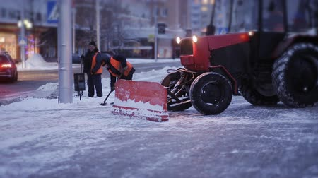snow plow : Cleaning car plowing snow to the side of the street. Cleaning the side of the road after a snowfall.