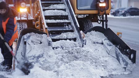 driveway : Snow removal in the city after a heavy snowfall. A lot of special equipment for snow removal.