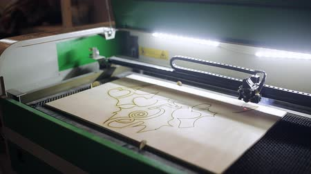 laser engraving : A machine for cutting plywood with a laser Stock Footage