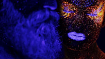 air kiss : Man and woman face in ultraviolet light