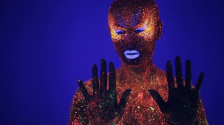 hallucination : Woman with fluorescent make up , creative makeup great for nightclubs, party, shows and music video