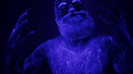 стриппер : An unreal dance of a man in the ultraviolet light. Strong, muscular man is a stripper. Стоковые видеозаписи