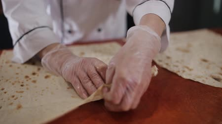 lavash : The woman prepares the pita bread for cooking kebabs at a roadside fast food restaurant Stock Footage