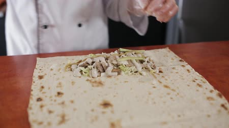 chawarma : Hand Wrapping Traditional Shawarma with Beef and Vegetables Stock Footage