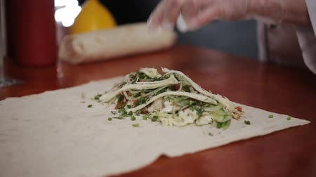 gyro : Hand Wrapping Traditional Shawarma with Beef and Vegetables Stock Footage