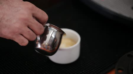 ostříhané : Barista Barrister makes coffees in coffee bar.latte preparation in coffee machine.Hands bartender cooking coffee, Interior bar, bartender, shallow depth of field Dostupné videozáznamy
