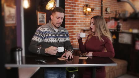 talk : Young couple at the bar drinking coffee and having a conversation. Stock Footage