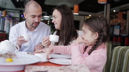 caring : Happy family in a cafe happy to eat pizza and socialize with each other