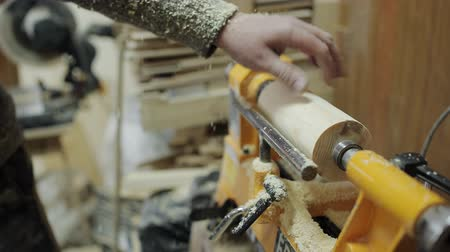 treadle : The carpenters hand processes the wooden part