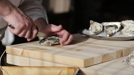 oysters : The chef at the restaurant opens oysters Stock Footage