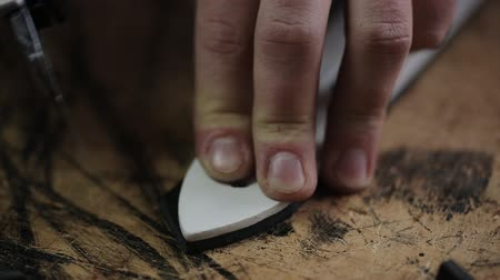 craftsperson : The Tanner in the Studio working on the production of leather belt. Stock Footage