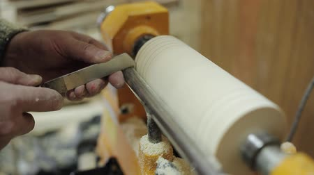 sander : Sanding wood on a lathe. Foot operated spring pole wood lathe.