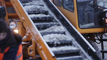 snow plow : municipal snow removal machine grabs snow from the street