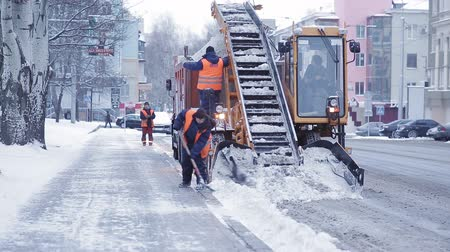 snow plow : Snow removal in the city after a heavy snowfall. A lot of special equipment for snow removal.