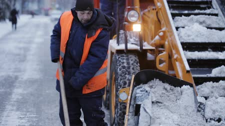 snow removal : Removing snow with plow. Close up of iron snowplow pushing a lot of snow away.
