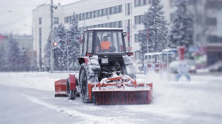 snow plow : Tractor cleaning snow snowthrower. Removing snow with plow. Close up of iron snowplow pushing a lot of snow away. Stock Footage
