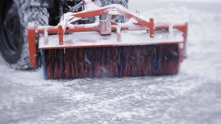 snow plow : Snow plow outdoors cleaning street. snowplow removing fresh snow from city square