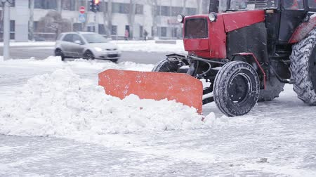 snow removal : Cleaning car plowing snow to the side of the street. Cleaning the side of the road after a snowfall.