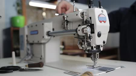 seams : Sewing machine in tannery Stock Footage