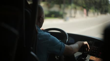 minibus : The bus driver is driving along the road. Stock Footage