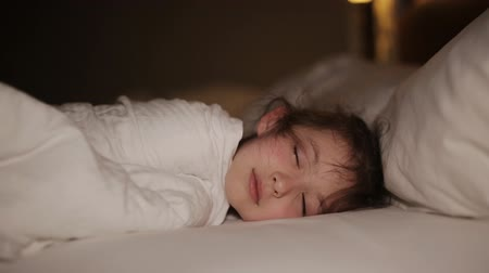 children only : Cute little girl sleeping in her bed