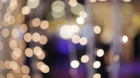 beaming : Bokeh of lights and garlands in the background dancing people Stock Footage