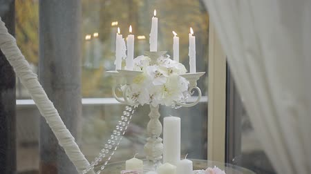 świecznik : decorating the wedding ceremony. Candlesticks with burning candles. Ancient candelabra with candles Wideo
