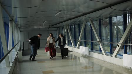 fool : Funny friends in anticipation of a vacation in a warm country enjoyed as children in the corridor of the airport.