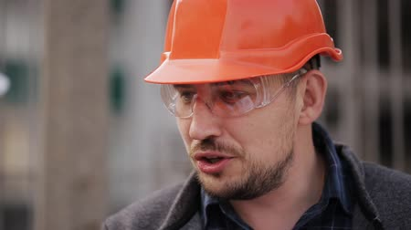 supervising : Engineer communicates and demonstrates the construction site of the two women inspectors, close-up Stock Footage