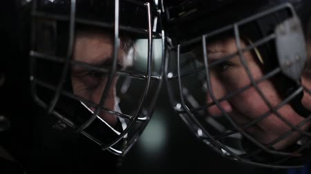 striker : The standoff between hockey players. Close-up of a goalkeeper and a forward face to face, forehead to forehead.