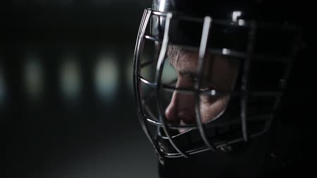 striker : Close-up face hockey goalie. Hockey goalkeeper is on the gate waiting for the opponent