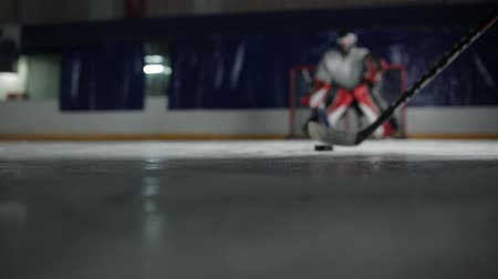 вратарь : Close up of a puck on ice hockey stick picks up the puck and breaks to the opponents goal