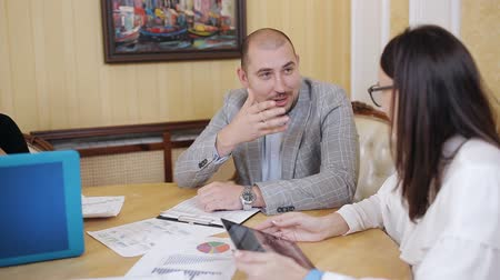 vita : Business teamwork of young managers and chief during serious and active scrum meeting, working with papers and reports Stock mozgókép