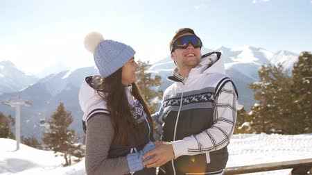 aspirace : Young couple in ski resort flirting and hugging on the mountain top.