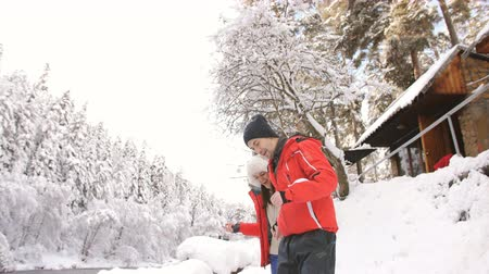 страна чудес : Couple in love walking in the fresh air near mountainous river winter landscape.