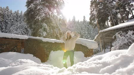faház : Happy woman in sun light beautiful frosty morning in the mountains near the Chalet.