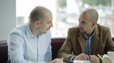collaborating : Two Businessmen Using laptop In Office Meeting