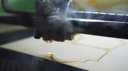 laser engraving : Laser Cutting Machine At Work. Plywood Cutting. Close-up Stock Footage