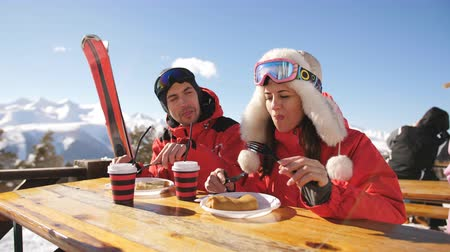 mulled wine : Man and woman in restaurant for lunch on top of a mountain. The ski resort. Stock Footage